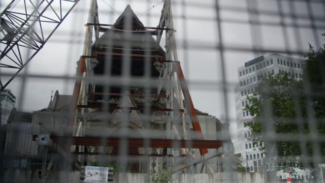 The earthquake damaged Christchurch Cathedral through a wire fence