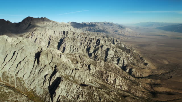 the eastern sierra nevada mountains rise out of the owens valley. - basin and range province stock videos and b-roll footage