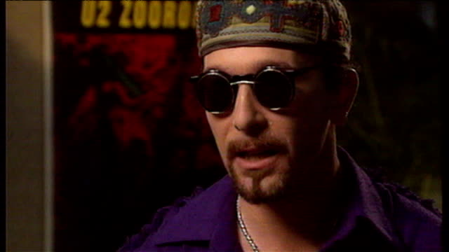 the edge speaking to reporter tsehai tiffen about 1993 zooropa concert tour theme of television - david 'the edge' howell evans stock videos and b-roll footage
