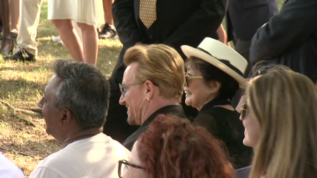 The Edge Yoko Ono Bono listen to V Bozeman performance at Bono and Yoko Ono honor John Lennon at Event on Ellis Island at Ellis Island on July 29...