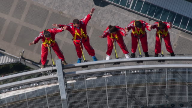 The EdgeWalk is an amusement in which thrillseekers can walk on and around the roof of the main pod of the tower at 356 m