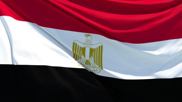 den egyptiska flaggan fladdrar i vinden - egypten bildbanksvideor och videomaterial från bakom kulisserna
