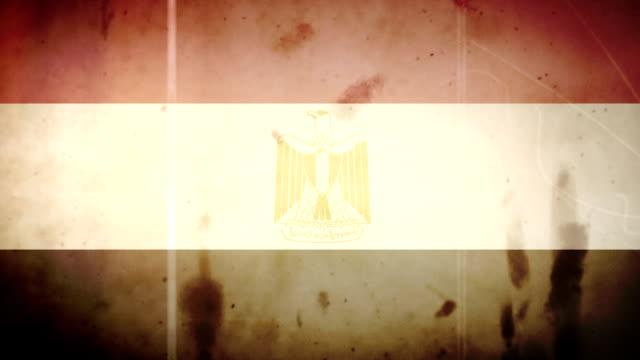 vidéos et rushes de le drapeau égyptien-grunge rétro vieux film loop - image détériorée