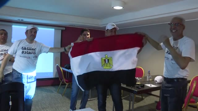 the egyptian football delegation in dakar celebrates after the annoucement that egypt will host the 2019 african cup of nations - national team stock videos & royalty-free footage