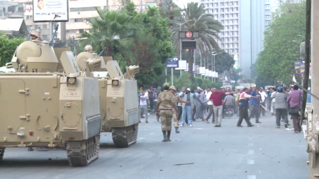 vídeos de stock, filmes e b-roll de the egyptian military deployed armoured vehicles on wednesday near demonstrations by supporters of mohamed morsi in cairo as aides of the embattled... - egito