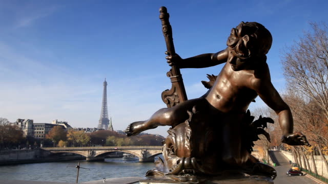 the eiffel tower from pont alexandre iii in paris, france. - pont alexandre iii stock videos & royalty-free footage