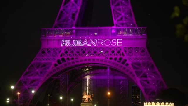 """the eiffel tower illuminates in pink for """"octobre rose"""" to start breast cancer awareness month, and displays the words """"ruban rose"""" , on october 01,... - month stock videos & royalty-free footage"""