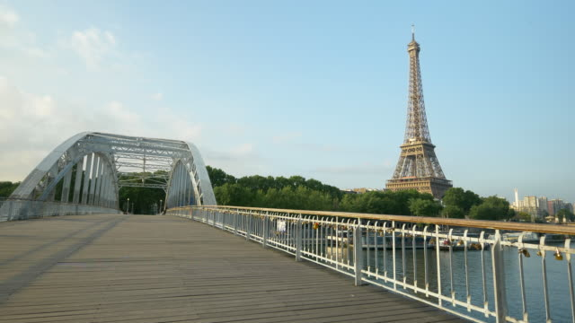 the eiffel tower in paris, france and the passerelle debilly footbridge. - slow motion - eiffel tower paris stock videos & royalty-free footage