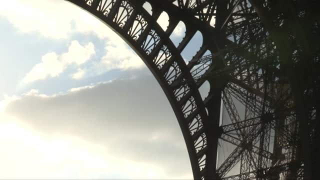 the eiffel tower in paris, france, from under with lens flares - low angle view stock-videos und b-roll-filmmaterial