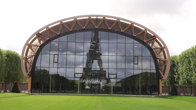 the eiffel tower is reflected in the facade of the grand palais ephemere installed on the champ de mars lawn on may 10, 2021 in paris, france.... - grand palais stock videos & royalty-free footage
