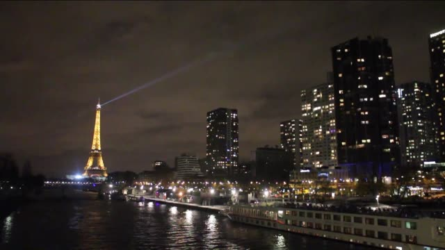the eiffel tower is seen in the dark during the earth hour initiative as a part of world wide fund for nature's awareness campaign on the occasion of... - earth hour stock videos & royalty-free footage