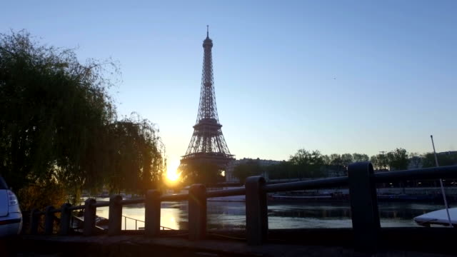 the eiffel tower, paris, at dawn. rising shot - paris france stock videos and b-roll footage