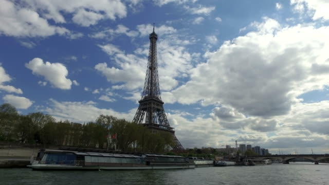 4k the eiffel tower, paris, from river seine - wide shot - eiffel tower stock videos and b-roll footage