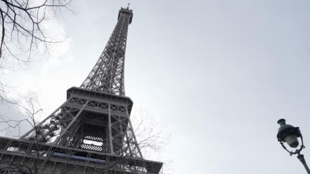 The Eiffel Tower Paris in winter against a blue sky.