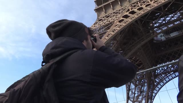 the eiffel tower remained closed to visitors on saturday after heavy snow left the stairs and viewing platforms covered in a slippery layer of ice - slippery stock videos and b-roll footage