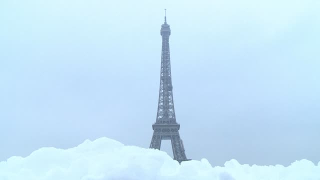 The Eiffel Tower remains closed for a second day in a row as snow sweeps across northern France causing traffic chaos in Paris and surrounding regions