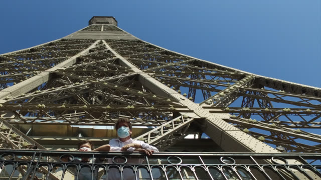 the eiffel tower reopens to the public on june 25, 2020 in paris, france. a child and his father on the second floor of the eiffel tower. - reportage stock videos & royalty-free footage