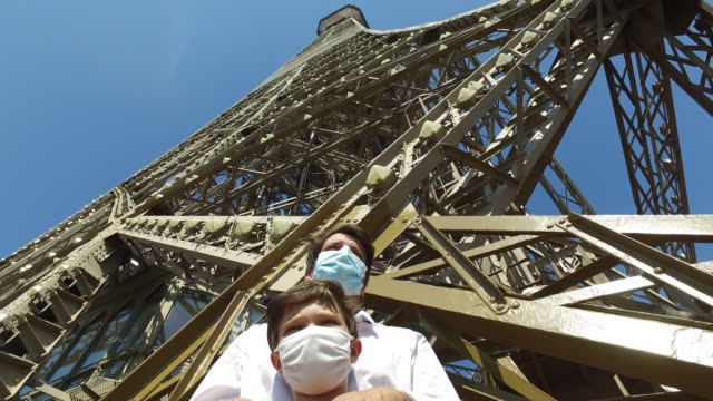 the eiffel tower reopens to the public on june 25, 2020 in paris, france. a child and his father on the second floor of the eiffel tower. - 50 54 years stock videos & royalty-free footage