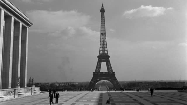 the eiffel tower rises above paris. - 1947 stock videos & royalty-free footage