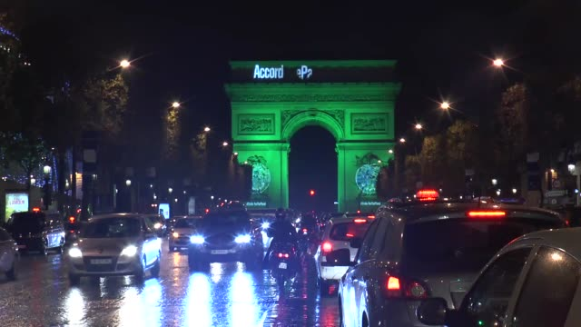"""the eiffel tower, river of seine and arc de triomphe are floodlit green to celebrate implementing the"""" paris climate change agreement"""" on november... - paris agreement stock videos & royalty-free footage"""