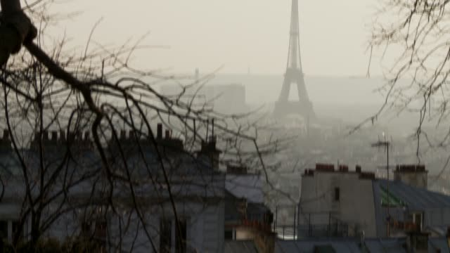 The Eiffel Tower soars above the skyline of Paris. Available in HD.