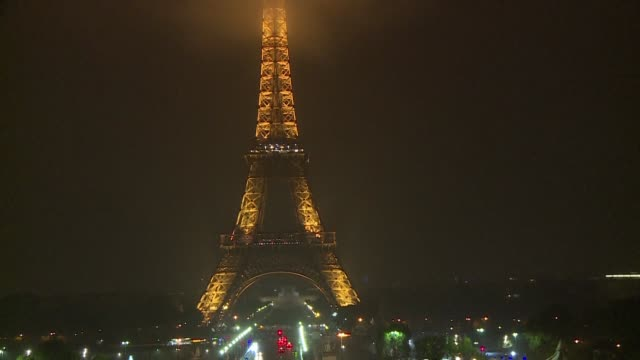 the eiffel tower turns off its lights at midnight paris time to honor the victims of a mass shooting in las vegas as well as a knife attack in a... - paris las vegas stock videos & royalty-free footage