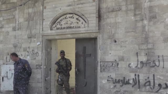 the elegant columns of a west mosul church stand plastered with islamic state group propaganda after the jihadists infamous religious police took... - infamous stock videos & royalty-free footage