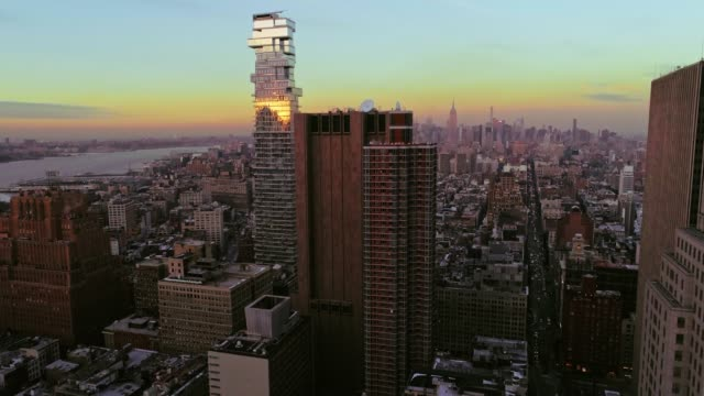 the elevated panoramic twilight view of manhattan downtown, new york city. vertical movement of the camera from below up - woolworth building stock videos & royalty-free footage