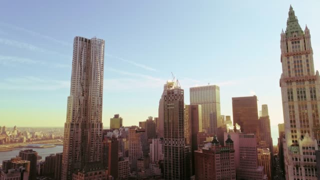 the elevated panoramic view of manhattan downtown, new york city. vertical panoramic movement of the camera from below up - woolworth building stock videos & royalty-free footage
