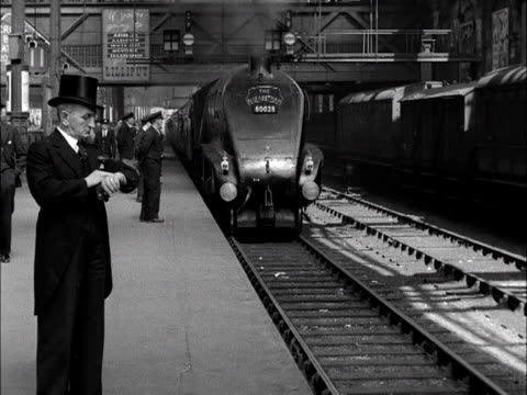 the elizabethan express passenger train pulls into edinburgh on its inaugural run from kings cross. 1953. - locomotive stock videos & royalty-free footage