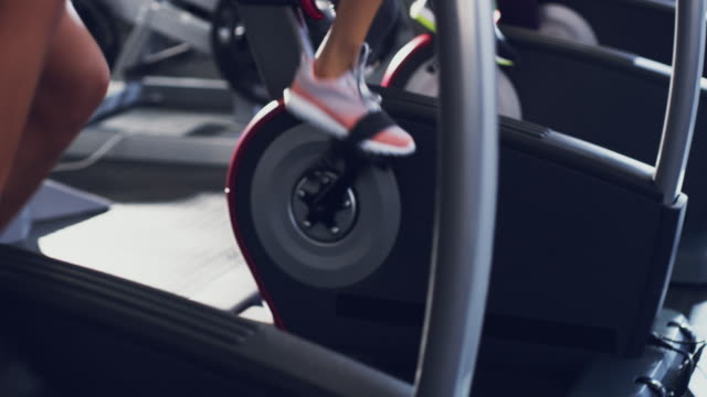 the elliptical machine will keep you fit all summer - health club stock videos & royalty-free footage