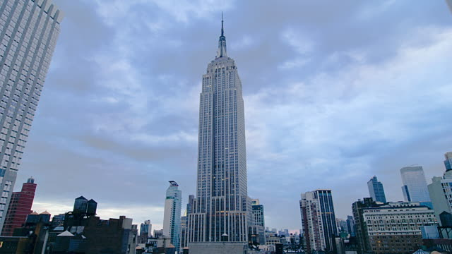 t/l the empire state building at dusk to night time / new york city, new york, united states - dusk to night stock videos and b-roll footage