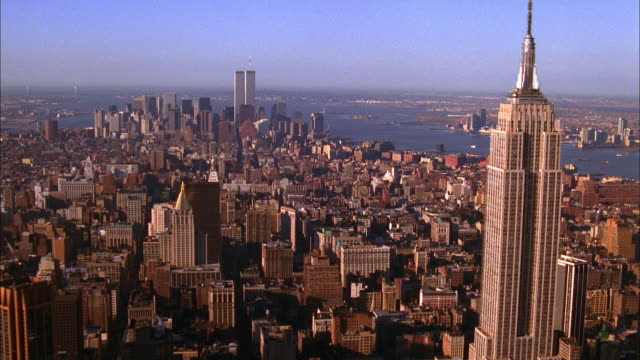 the empire state building dominates the new york city skyline. available in hd. - world trade centre manhattan stock videos and b-roll footage