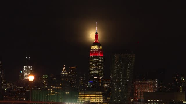 the empire state building is seen as a super moon rises in new york, united states on february 19, 2019. - empire state building stock videos & royalty-free footage