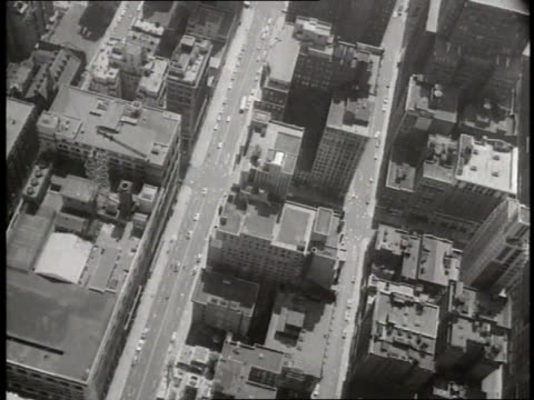 the empire state building overlooks new york city streets - 1930 stock-videos und b-roll-filmmaterial