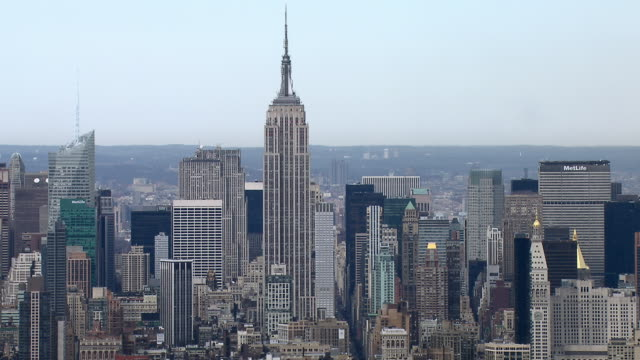 The Empire State Building, surrounded by other skyscrapers of Midtown Manhattan.