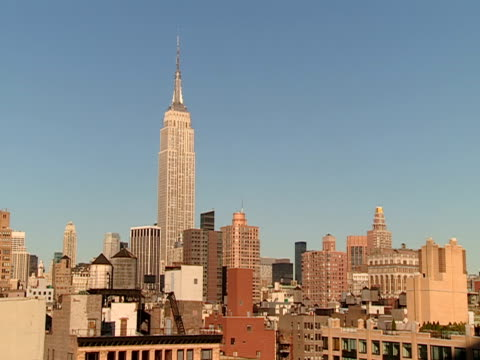 the empire state building towers above other buildings in new york city. - other stock videos & royalty-free footage
