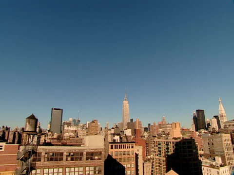 the empire state building towers above other high-rises in new york city. - other stock videos & royalty-free footage