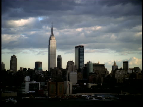 The Empire State Building towers over the skyline of Midtown Manhattan.