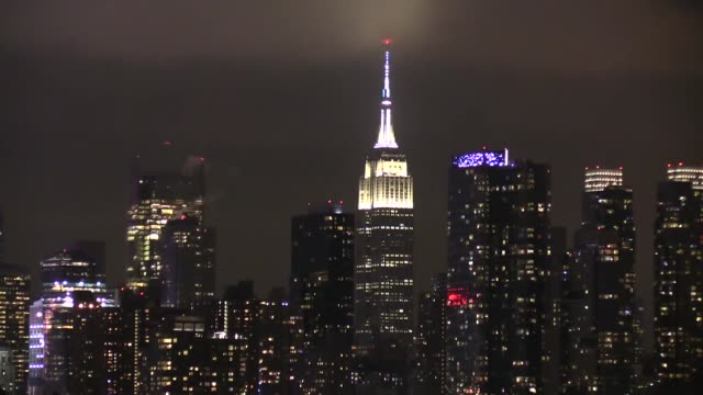 the empire state building's lights are turned off to mark the earth hour 2017 environmental campaign in new york usa on march 25 2017 the lights were... - earth hour stock videos & royalty-free footage
