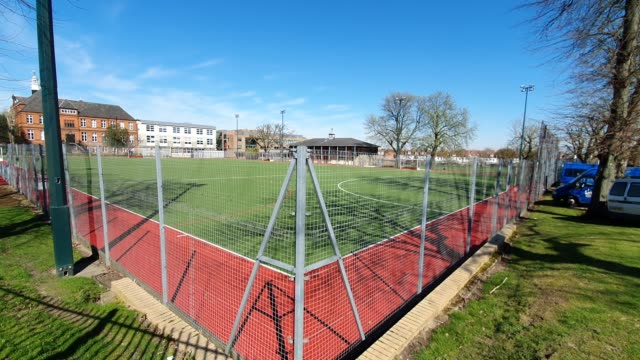 the empty hockey field at alleyn's school closed during the coronavirus pandemic on march 23 2020 in east dulwich london england - brian dayle coronavirus stock videos & royalty-free footage