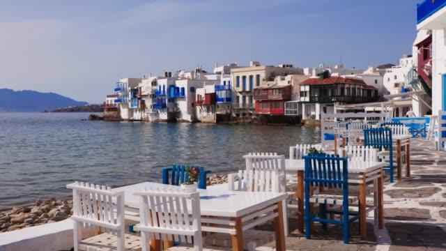 the empty restaurants of the greek island of mykonos in front of mikri venetia or little venice at mykonos town in greece greek island mykonos waits... - mykonos stock videos & royalty-free footage