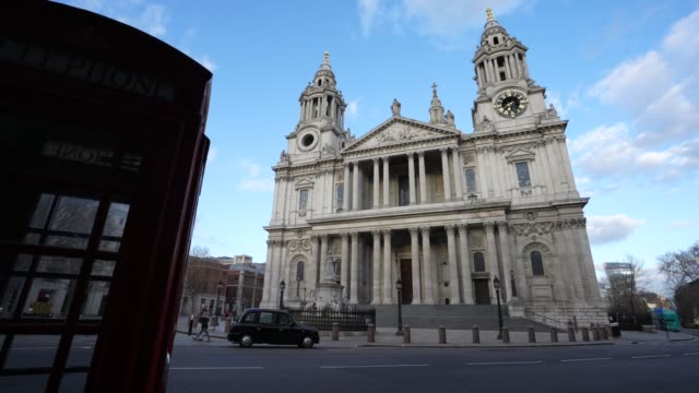 the empty streets around st paul's cathedral during london's lockdown due to the coronavirus covid19 pandemic on april 02 2020 in london england - cathedral stock videos & royalty-free footage