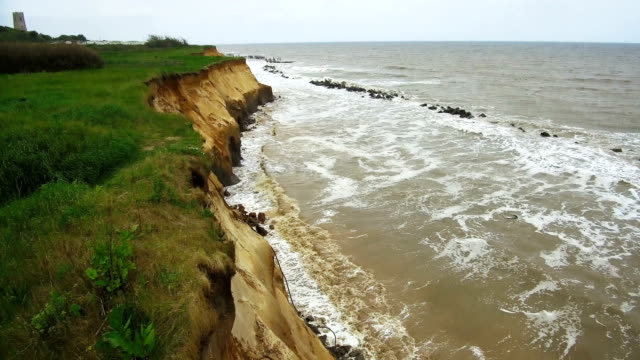 the end of a tramac road shows the devastation caused by coastal erosion of the cliff face in the village of happisburgh on june 4 2018 in great... - eroded stock videos & royalty-free footage