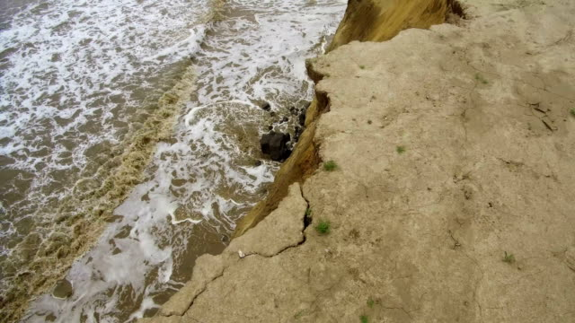 The end of a tramac road shows the devastation caused by coastal erosion of the cliff face in the village of Happisburgh on June 4 2018 in Great...