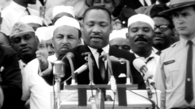 the end of mlk's 'i have a dream' speech during the civil rights march on washington / crowds watching speech / lincoln memorial / washington... - rede stock-videos und b-roll-filmmaterial