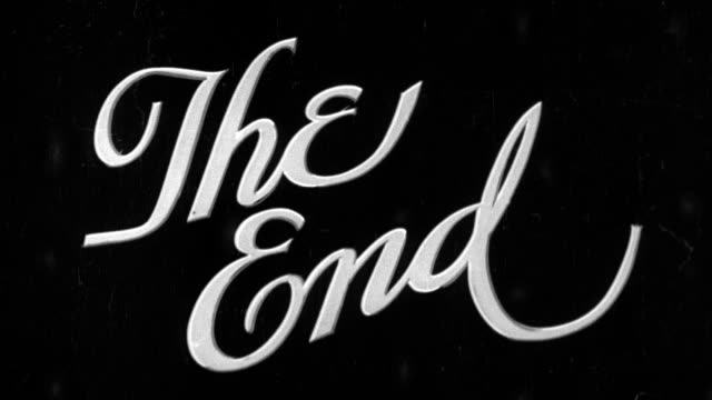 vídeos de stock, filmes e b-roll de 'the end' title slate in script lettering - acabando