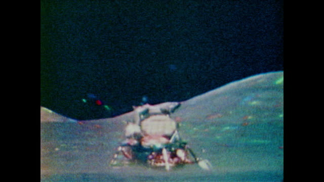 vídeos de stock e filmes b-roll de the engine fires on the lunar excursion module sending the top half back into space to rendezvous with the main spacecraft of apollo 11 - 1969