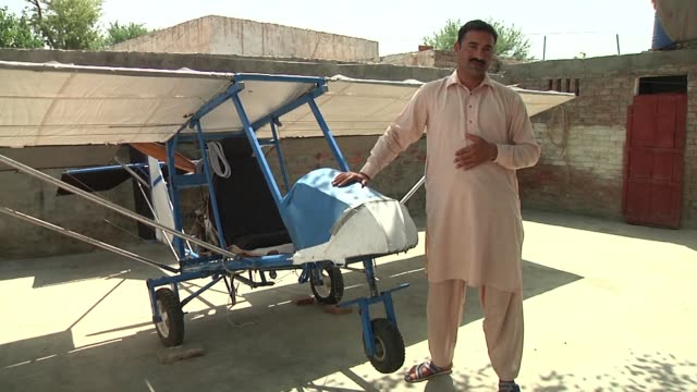 the engine is from a roadcutter the wings are burlap the wheels are borrowed from a rickshaw pakistani muhammad fayyaz worked as a popcorn seller... - popcorn stock videos & royalty-free footage
