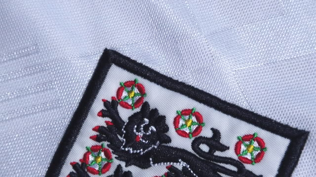 the england crest on their home shirt on may 28 2020 in manchester england - cat family stock videos & royalty-free footage